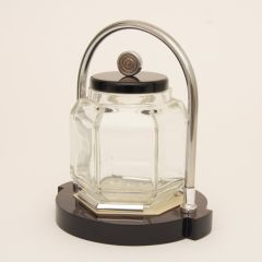 A faceted glass ice bucket designed by Louis Prodhon in 1930s France.