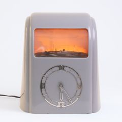 J.S. Thatcher grey Art Deco Vitascope Clock with automated Clipper. Illuminated window gently cycles from sunrise to sunset c.1941 and produced by Vitascope Industries Ltd on the Isle of Mann