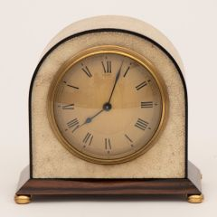 An Asprey art deco clock in cream shagreen with black edging on a polished rosewood base and a Swiss movement by Buren c.1920